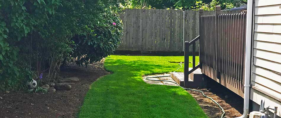 This yard in Troutdale, OR has regularly scheduled lawn care services.