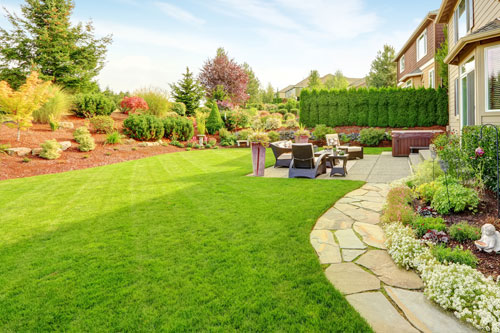 Happy Valley backyard with professionally mowed lawn and maintenance.