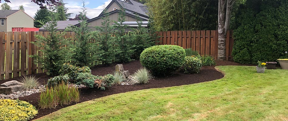 Portland, Oregon home with fresh mulch bed and landscape design.